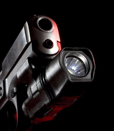 weaponlight that is mounted on a semi-automatic handgun Stok Fotoğraf