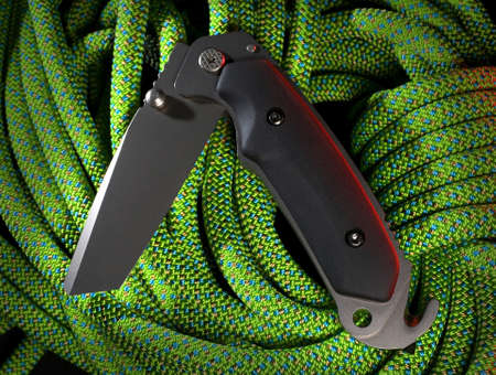 Folding tool die een raam breker en de gordel snijder heeft Stockfoto
