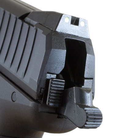 Hammer and decocker on the back of a polymer handgun Фото со стока
