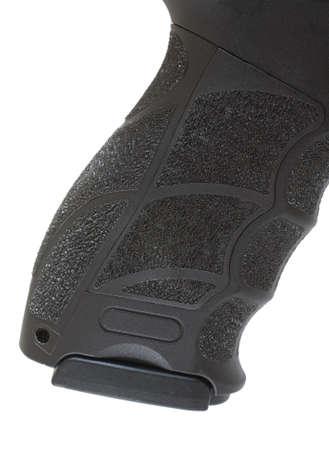 grip: Polymer handgun grip that has the magazine inserted Stock Photo