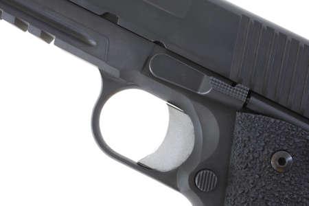 gatillo: Disparo s�lido y seguro del gatillo de un arma de fuego negro Foto de archivo
