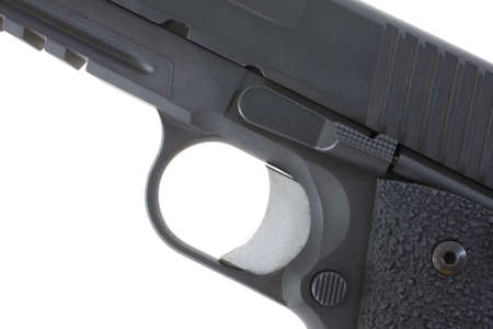 Solid trigger and trigger guard on a black handgun Stock Photo - 10264766