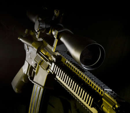 Assault rifle on a dark background with yellow side lights