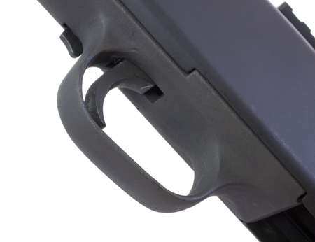 Isolated view from the bottom of a black shotgun trigger