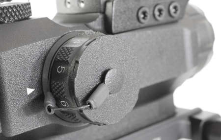 brightness: Knob for adjusting reticle brightness on a tactical riflescope Stock Photo