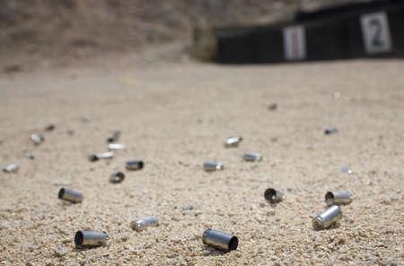 dozens: Dozens of empty ammo shells on the firing line of a range