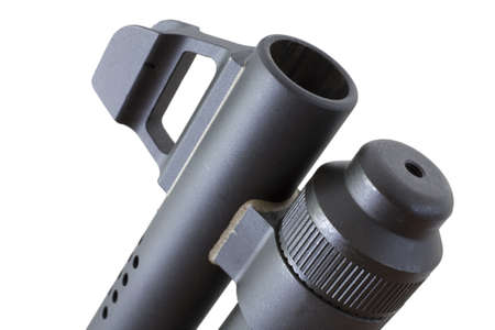 Barrel of a pump action shotgun and front sight on white