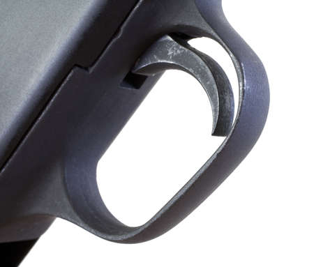 trigger: Old black trigger that is on a pump action shotgun Stock Photo