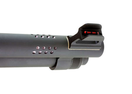porting: Isolated shotgun barrel with porting and a red fiber optic sight Stock Photo