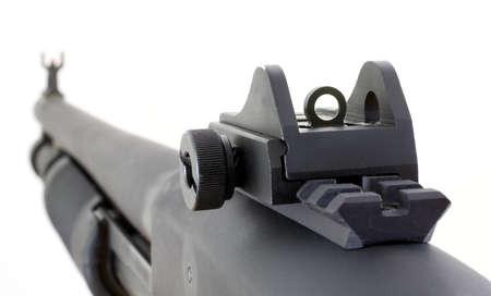 Rear peep sight and front fiber option on a black shotgun 版權商用圖片