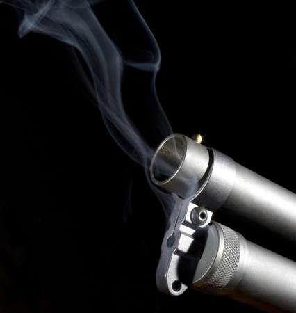 Shotgun barrel that is hot enough that smoke is around it