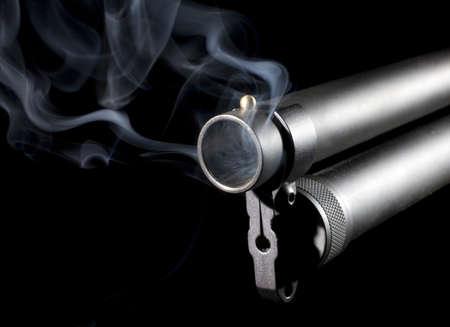 Smoke that is coming from the barrel of a twelve gauge shotgun Reklamní fotografie