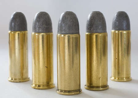 Five cartridges with lead bullets made for 44 special guns