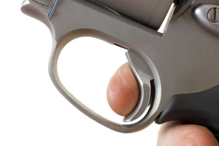 Finger on the trigger of a stainless steel revolver Stock Photo - 13925061