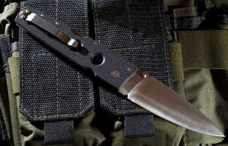 ruck sack: Knife that is on a nylon ruck sack in the night