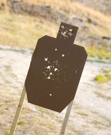Cardboard silhouette target that has been shot by a shotgun Stock Photo - 15153419