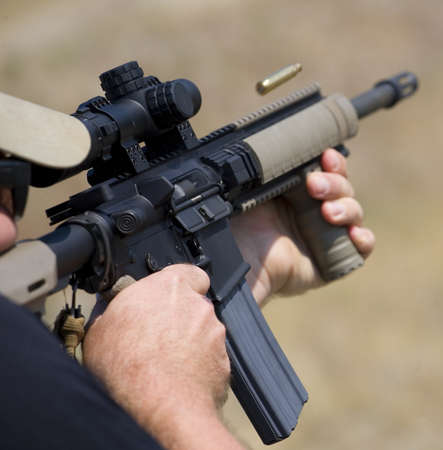 Brass hangs in the air as a shooter takes a single shot