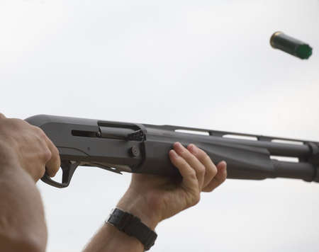 finger on trigger: Empty shotshell after ejection from a semi auto shotgun