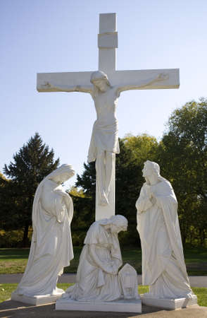 Statue in a cemetery depicting Jesus on the cross and Mary photo