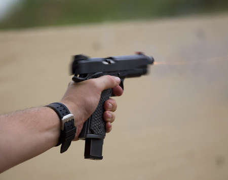 shooters: Semi auto handgun that is recoiling in the shooters hand