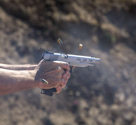 unleashed: Handgun in motion that has just unleashed four shots