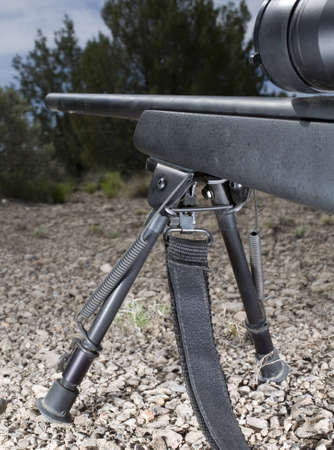 ridgeline: Rifle on a ridgeline that is stabilized on a bipod Stock Photo