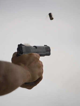 Empty shell being ejected from a semi automatic handgun
