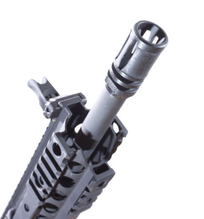 flash hider: Device often found on the front end of an assault rifle