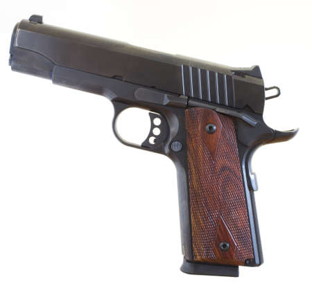 Isolated semi automatic handgun that was designed in 1911 Stock Photo - 16435019
