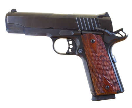 Semi automatic handgun with a round in the chamber and safety on Stock Photo - 16434989