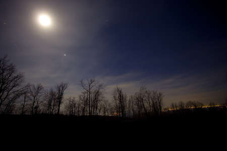 winchester: Moon that is setting over the Blue Ridge of Virginia near Winchester