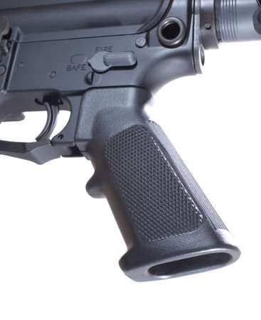 grip: Pistol grip and trigger that are on an AR-15