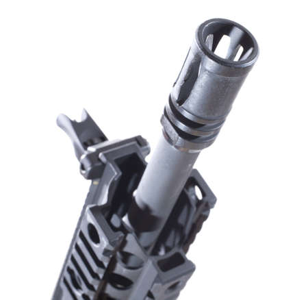 flash hider: Flash hider on the end of an assault rifle barrel