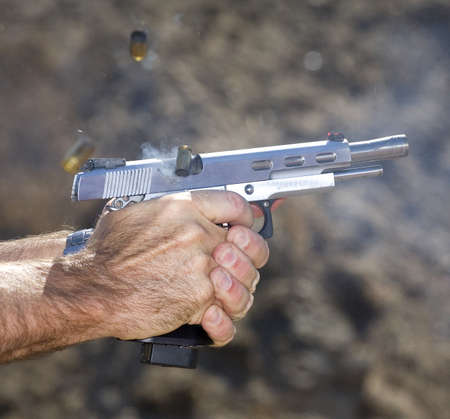 Three rounds that have been shot from a semi automatic pistol Stock Photo - 17030124