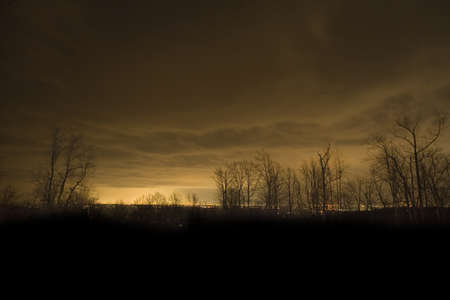 winchester: Glow against the clouds from the city of Winchester Virginia Stock Photo