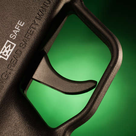 trigger: Rifle trigger that has a green background behind