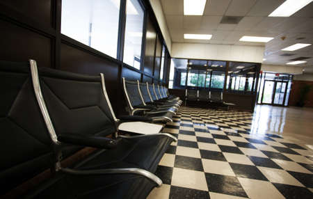 Empty chairs at the luggage claim area in an airport
