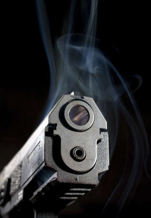 barrel pistol: Polymer handgun that has smoke around its muzzle