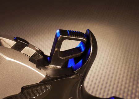 Hammer on a semi automatic handgun that is cocked with blue highlights