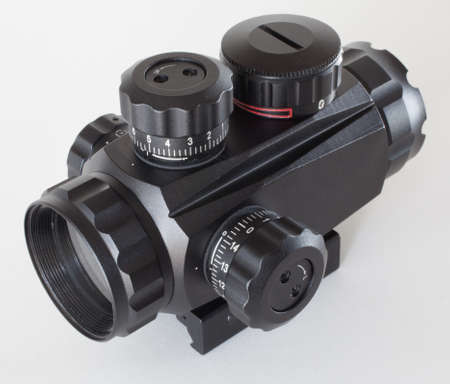Rifle scope that has adjustment knobs on all sides