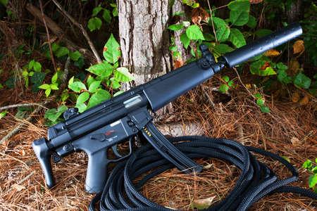 Short assault rifle that has a suppressor attached Banco de Imagens