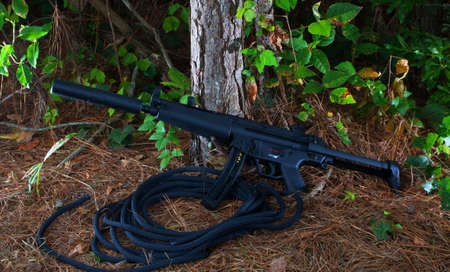 the silencer: Assault rifle that has a silencer on its barrel Stock Photo