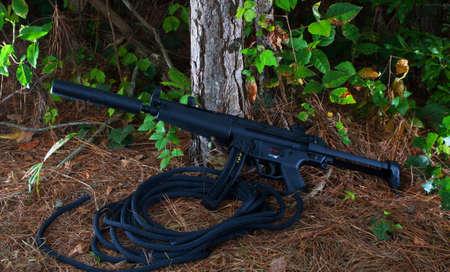 Assault rifle that has a silencer on its barrel 版權商用圖片