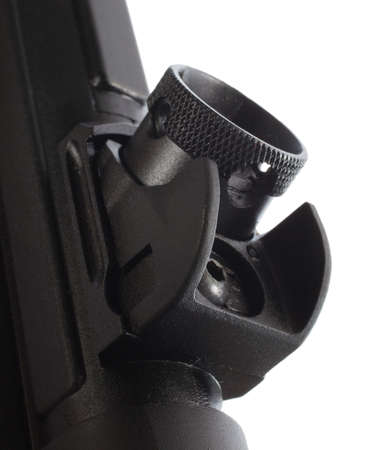rotates: Rear sight on an assault rifle that rotates