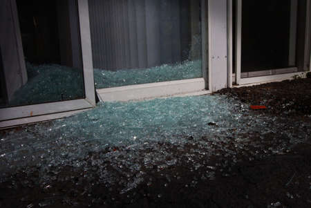 Shattered Glass In The Night Near A Sliding Glass Door Stock Photo