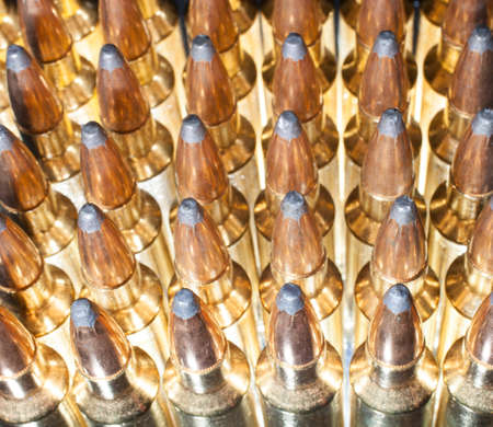 high powered: Ammo for a high powered rifle that has light from behind Stock Photo