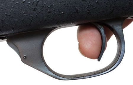 trigger: Finger on the trigger of a high powered rifle