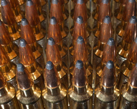 High powered rifle ammunition that is lined up Stock Photo