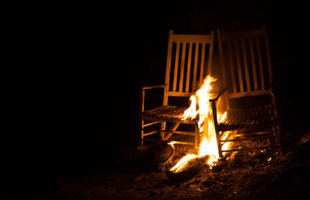 cinders: Fire that is burning on a pair of old rocking chairs