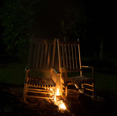 cinders: Two rocking chairs that have fire between them